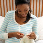 Pregnant lady knitting baby clothes
